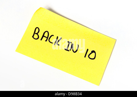 Back in 10 written on a yellow post-it note - Stock Photo