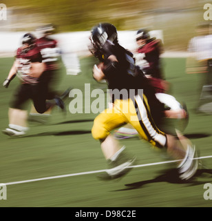 players fighting for the ball, motion blur - Stock Photo