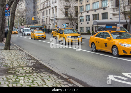 yellow Taxi Cabs on 5th Avenue New York - Stock Photo
