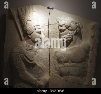Plaster cast of upper part of a marble relief.  King Antiochus 1 of Commagene clasps the right hand of Hercules. - Stock Photo