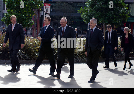 Businessmen on Queen Street in Auckland city, New Zealand. 36% of NZ men working full-time worked 50 or more hours. - Stock Photo
