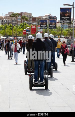 tourists on segway tour in port vell barcelona catalonia spain - Stock Photo