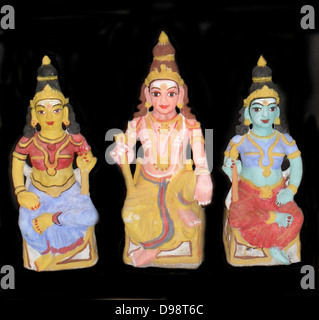 The Hindu Trimurti or Trinity represented in small statuette figures, from early 20th Century India. (Left) Brahma, - Stock Photo