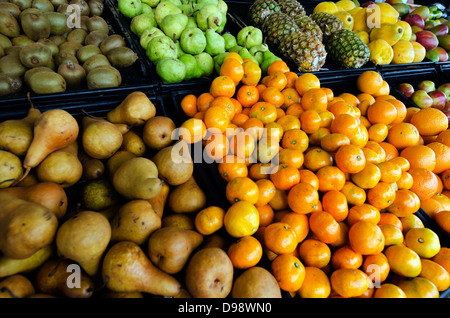 Fresh fruit on display in a farmers Market. - Stock Photo