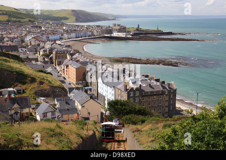 View of Aberystwyth beach, bay and promenade from Constitution Hill, its funicular railway in the foreground - Stock Photo