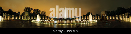 High resolution panorama of the National World War II Memorial with the Washington Monument in the distance at night. - Stock Photo