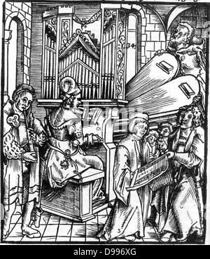 16th Century German woodcut depicting musical instruments being played. Instruments included are the organ and flute. - Stock Photo