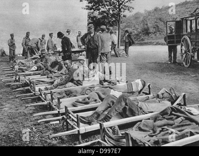 World War I 1914-1918: Wounded Austrian soldiers waiting on stretchers outside a field hospital; One of the Battles - Stock Photo