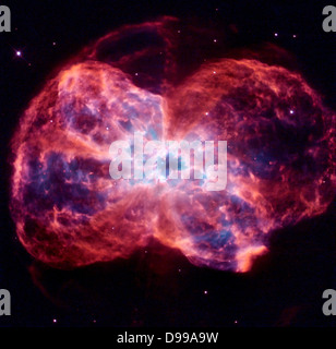 The star is ending its life by casting off its outer layers of gas, which formed a cocoon around the star's remaining - Stock Photo