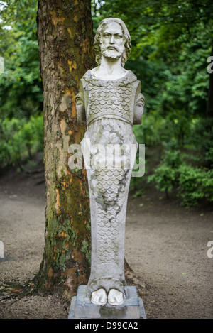 BRUSSELS, Belgium - A statue, partly a male mermaid, in Brussels Park across from the Royal Palace of Brussels in - Stock Photo