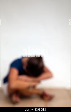 Blurred Image of Girl on Floor - Stock Photo