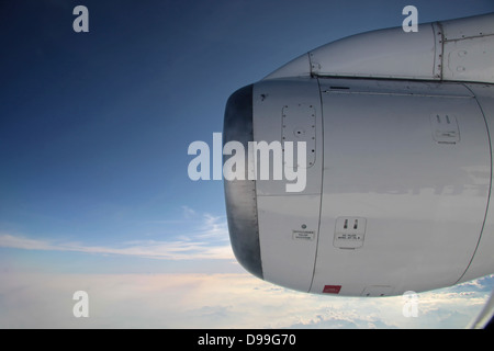 aerial photography with aircraft engine blue sky and clouds - Stock Photo