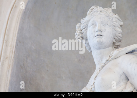 Ancient statue of a young woman in an Italian church close to Torino, north Italy - Stock Photo