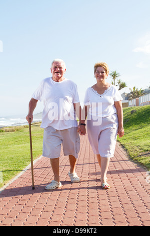 happy senior couple walking outdoors - Stock Photo