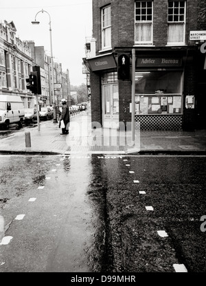 Wet street scene in Marchmont Street, near the Brunswick Centre, Russell Square Bloomsbury, London - Stock Photo