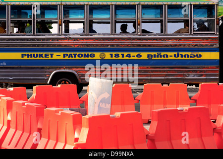 PATONG BEACH, PHUKET, THAILAND jANUARY 15 2013: Passengers bound for Phuket Town wait in a bus at bus depot - Stock Photo