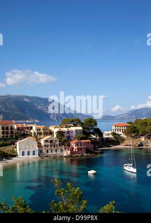 Assos harbour Kefalonia Greece Ionian Island Greek fishing village showing Myrtos Bay - Stock Photo