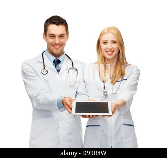 young doctors showing tablet pc - Stock Photo