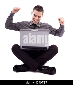 Successful young man holding his laptop on his lap, isolated on white background in full length pose - Stock Photo