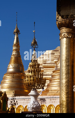 Golden stupas of the Shwedagon Paya (Buddhist temple) in Rangoon ( Yangon) Burma (Myanmar). - Stock Photo