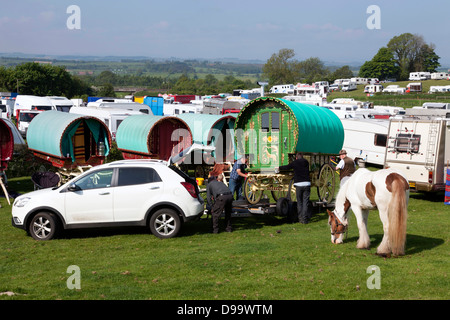 Travellers unloading a bow top gypsy caravan at the Appleby Horse Fair, Appleby-in-Westmorland, Cumbria, England, - Stock Photo