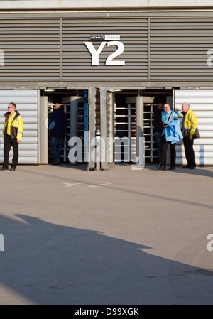 Turnstiles at the Etihad Stadium, home of Manchester City Football Club  in the English Premier League - Stock Photo