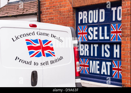 A sign and van outside P & S Butchers saying Proud To Sell British Meat in Holt , Norfolk , England , Britain , - Stock Photo