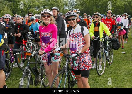 Clapham Common, London UK. 16 June 2013. Cyclists line up for the staged start of the British Heart Foundation London - Stock Photo