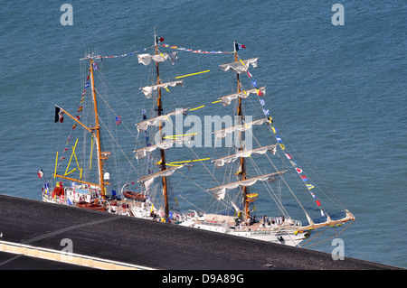 Mexican square rigged sailing ship alongside a pier on the San Francisco Embarcadero - dressed overall with flags - Stock Photo