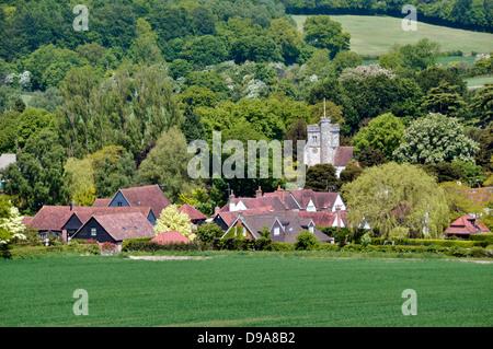 Bucks - Chiltern Hills - tightly framed landscape Little Missenden village - church tower - rooftops - wooded hillsides - Stock Photo