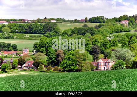 Bucks - Chiltern Hills - landscape - Little Missenden valley - early summer sunlight - mature trees and rural buildings - Stock Photo