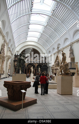 Crowds look at exhibits in the Victoria and Albert Museum, London. The Victoria and Albert Museum (often abbreviated - Stock Photo