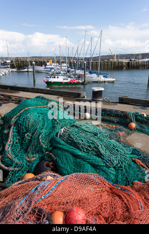 Commercial fishing nets stacked by the Harbour in Scarborough North Yorkshire - Stock Photo