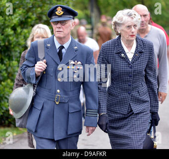 Harrogate, Yorkshire, UK. 16th June, 2013.  A man dressed as a RAF Flight Lieutenant and and a woman in 1940's dress - Stock Photo