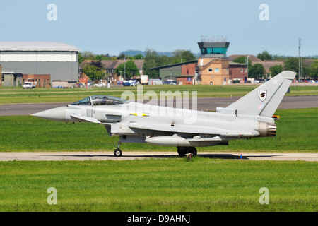 RAF Eurofighter Typhoon aircraft of 11 squadron waiting to join the runway at RAF Coningsby in Lincolnshire - Stock Photo