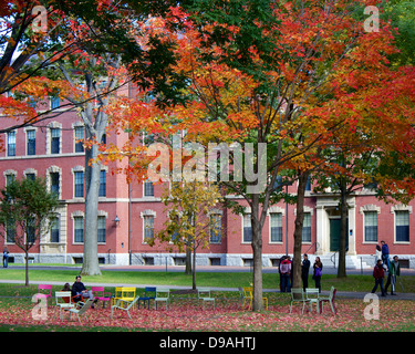 Colorful fall foliage in Harvard Yard, the old heart of the campus of Harvard University in Cambridge, MA, USA. - Stock Photo