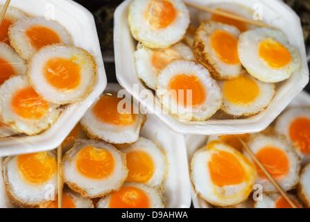 Scrambled quail eggs at the eastern market close up - Stock Photo