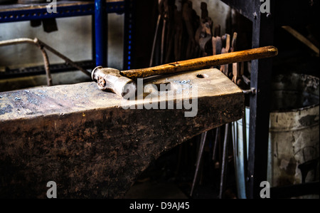 The anvil and a hammer in a blacksmiths workshop Stock Photo