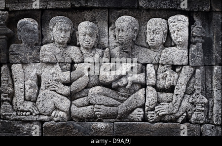 Ancient carving from buddhist Borobudur temple. Indonesia, Java - Stock Photo