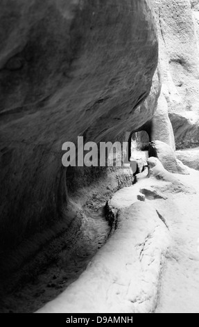 Water channel in the walls of Siq in Petra, Jordan - Stock Photo