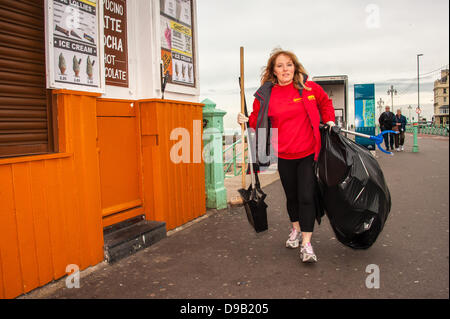 Brighton, UK. 17th June, 2013. Monday morning clean up - Brighton Pier staff clean up the mess as the city's cleaners - Stock Photo