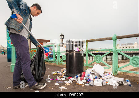 Brighton, UK. 17th June, 2013. Monday morning clean up - Brighton Pier workers clean up the mess as the city's cleaners - Stock Photo