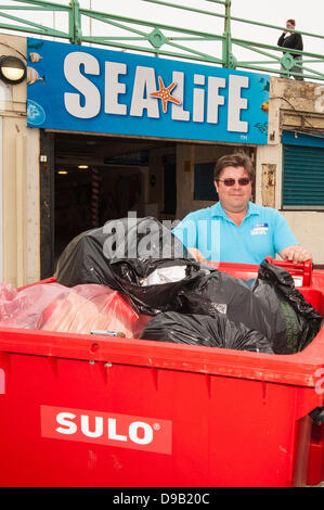 Brighton, UK. 17th June, 2013. Max Levinston with just some of the rubbish collected by staff from his Brighton - Stock Photo
