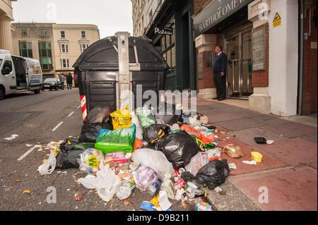 Brighton, UK. 17th June, 2013. Sin Bin City -Rubbish strewn street by Plateau Restaurant, Batholemews, in Brighton. - Stock Photo