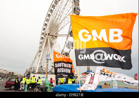 Brighton, UK. 17th June, 2013. Council workers protest against paycuts in Brighton by the Brighton Wheel. Refuse - Stock Photo