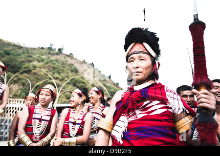 Naga tribal people in traditional outfit during the annual Hornbill Festival at Kisama, Kohima, Nagaland, India - Stock Photo