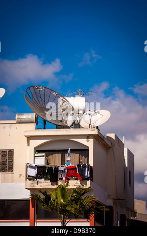 Satellite dishes and aerials on roof of building, Cyprus - Stock Photo