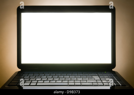 black laptop blank screen and no sign keyboard - Stock Photo