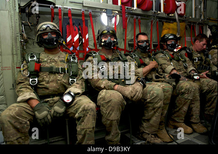 US Army Operational Detachment Alpha from 7th Special Forces Group waits onboard a C-130 to conduct a high altitude - Stock Photo