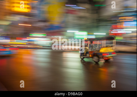 Tuk-tuk in motion blur, Bangkok, Thailand - Stock Photo